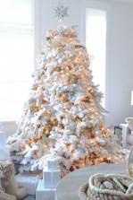 flock-christmas-tree-with-lights-and-gilded-pinecones-freshouz