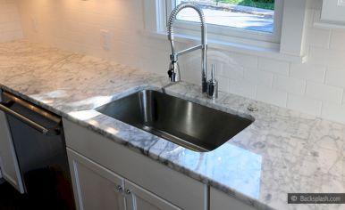 White Countertop With Subway Tile Backsplash
