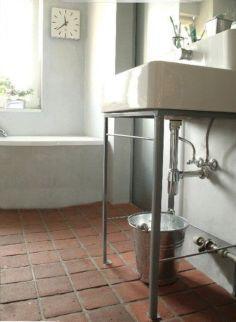 Bathroom With Terracotta Floor Tile