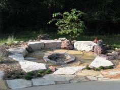 Backyard Patio With Stone Firepit 10
