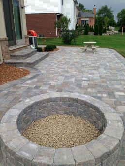 Backyard Patio With Stone Firepit 26