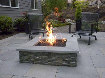Backyard Patio With Stone Firepit 9