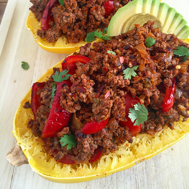 Spicy Spaghetti Squash Beef Bowl: pastured ground beef mixed with veggies and spices packed into a squash for a healthy, seasonal presentation.