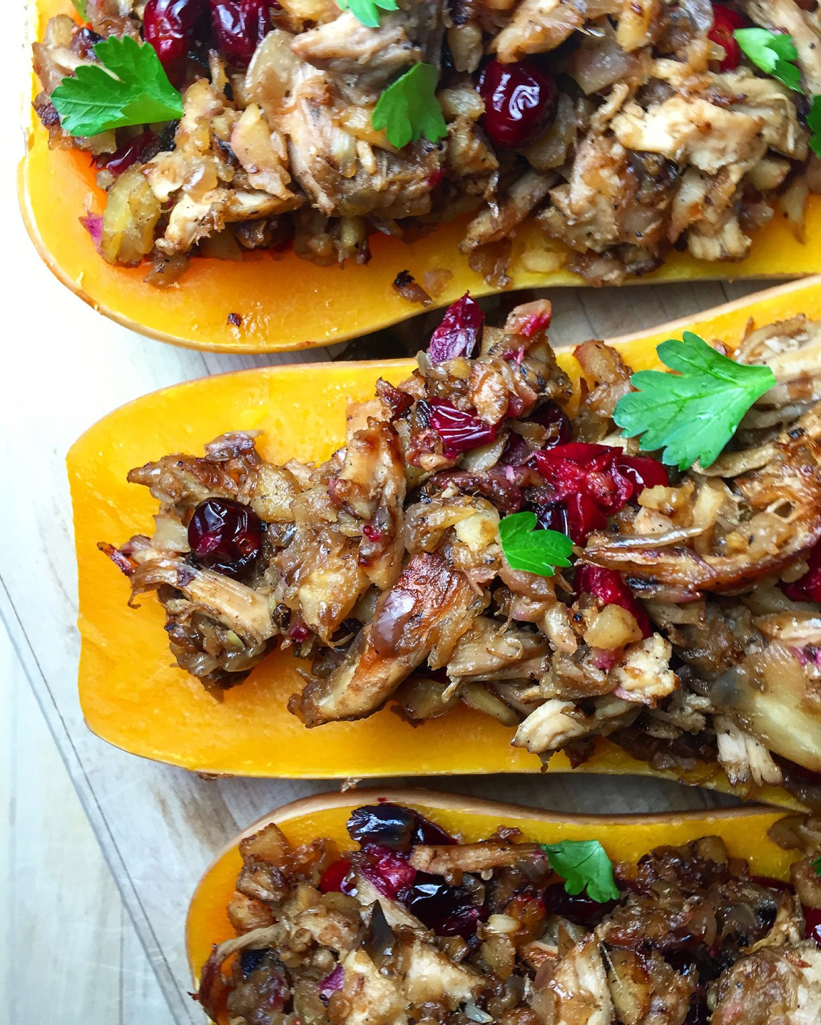 Cranberry Chicken Stuffed Squash: warmly savory shredded chicken, the subtle sweetness parsnips, and tart pop of cranberries makes this a great dish for the holiday season! GrokGrub.com
