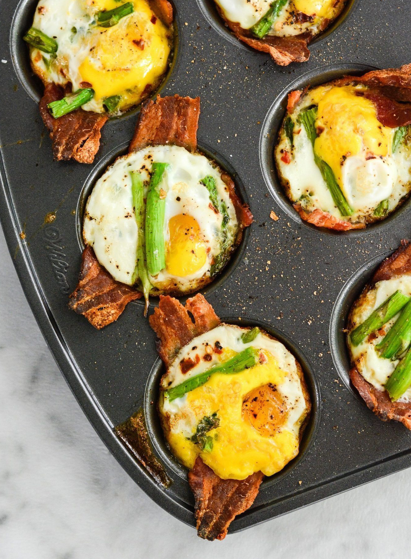 The thick-cut bacon paired with asparagus in these Paleo Egg Cups is what breakfast dreams are made of. Get the recipe.