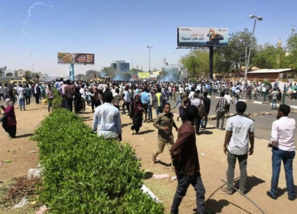 Some Protesters in Khartoum outside the army headquarters e1554672871598