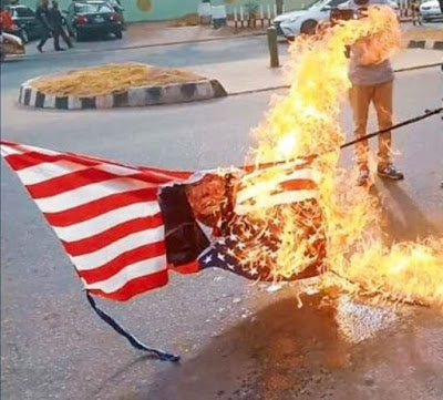 Photos: Shiites Members Burn US Flag, Demands El-zakzaky Release, As they Protest In Abuja