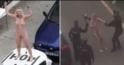 VODEO: Woman Strips naked, Jumps On Police Car After Leaving Court For Breaching Lockdown Order