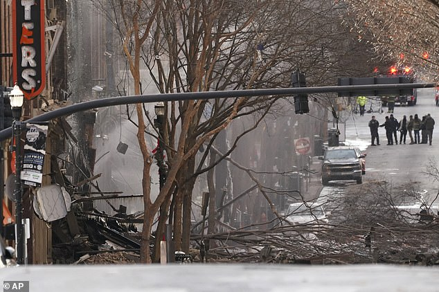 37258590 0 Emergency personnel work at the scene of an explosion in downtow a 7 1608912995408
