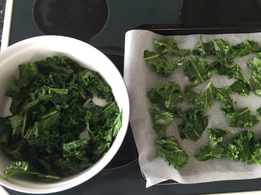 place kale pieces flat on baking tray