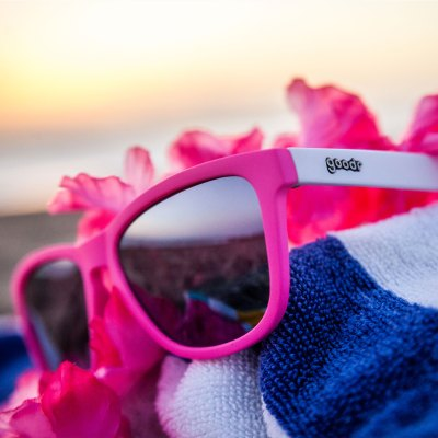 "58da7667a3 Some companies might simply call this pair of glasses ""neon pink and white  with chrome lenses."" Goodr calls ..."