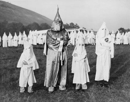Klan members with young recruits