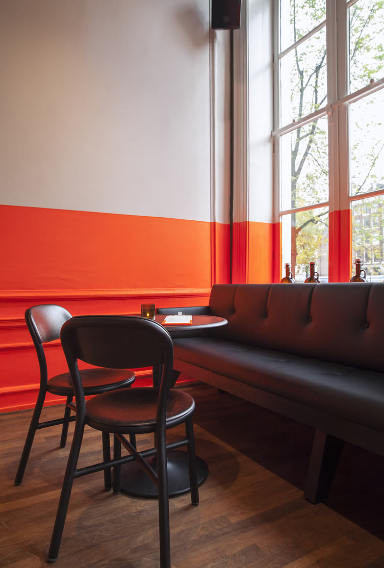 Orange paint and timber floor