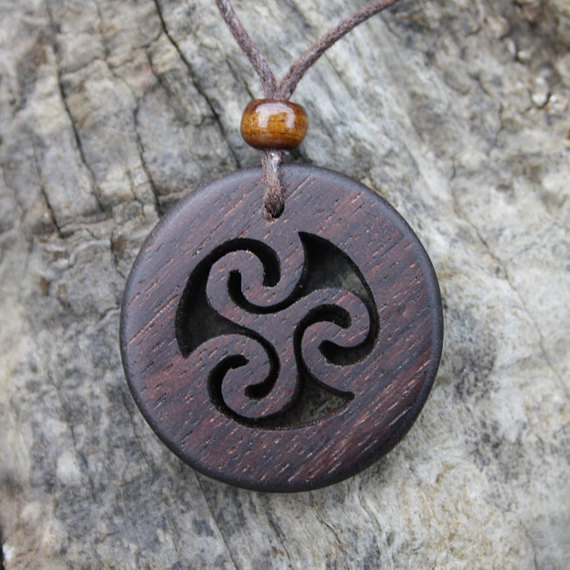 Hand carved wooden celtic triskele pendant aloadofball Image collections