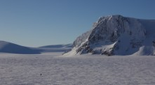 Photo taken from the root of Newtontoppen. In the background you can see our camp, and Thomas skiing.