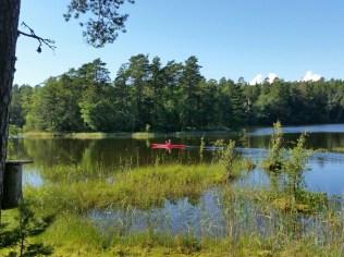 Yey! I'm kayaking around an island on a lake on an island on the sea!