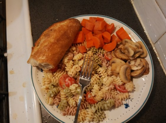 A meal I cooked for myslef with ingredients fom Trader Joe's near the office in Chelsea. The lines are dizzyngly long, but there are some 20 billing counters. I've never had a faster checkout. Fusili in a Greek yoghurt dressing, boiled carrots, salt and papper sauteed mushrooms, and a baguette.
