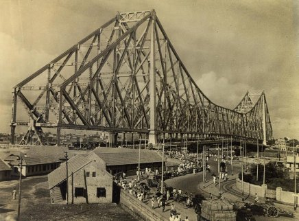 Calcutta boasts the third largest cantielver bridge in the world. Its real importance, however, lies inthe fact that it serves as Calcutta's gateway to the wese, being the city's only bridge spanning the Hooghly. Taking 7 years to build, it cost $10,000,000. It towers 310 feet as the city's highes structure, is 2,150 feet long with a center span of 1,500 feet. It was completed in 1942, opened in February, 1943.