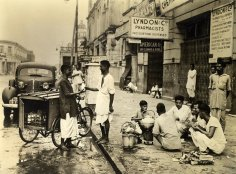 Early morning in many calcutta street finds natives huddled around a breakfast teapot, having risen from their sidewalk abode. The milkman makes a regular stop at this community gathering on busy Park street.