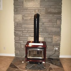 A Pacific Energy Red Porcelain Wood Stove by Friendly Fires.ca in Cobourg, Ontario.