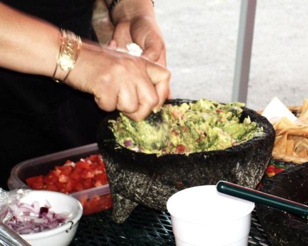 Sandra prepare guacamole in a Mexican moljajete
