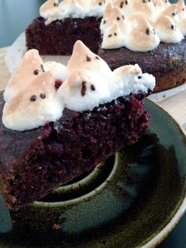 ghost meringues on cake