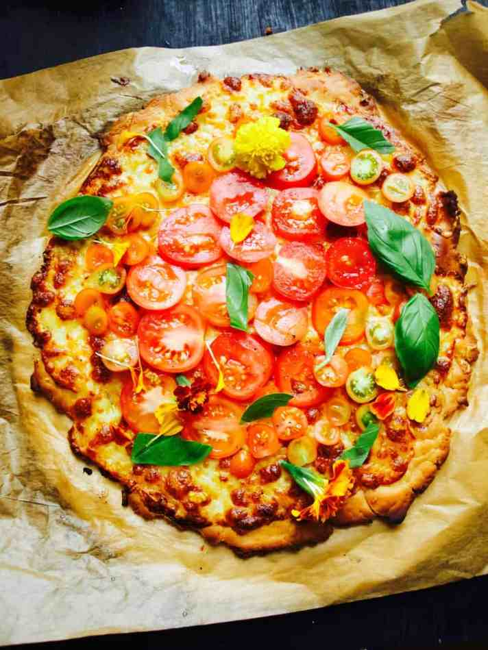 Gluten free pizza topped with fresh ingredients