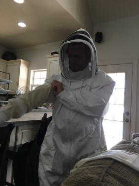 Eric trying on the beekeeping suit for size