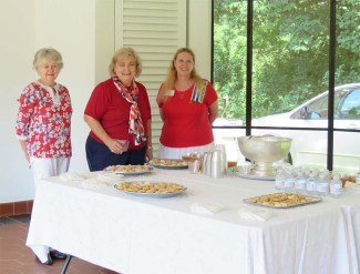 Friends of Chatham members Sharon Adinolfi, Cathy Walker and Beth Stenstrom prepare for the reception.