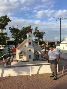Paulino in front of the only Protestant church among the replicas