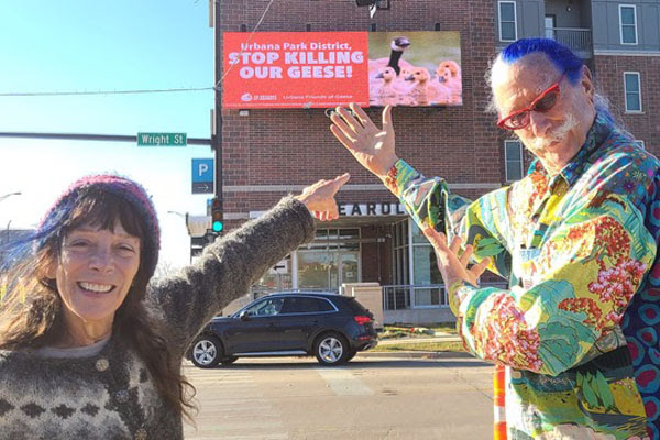 Friends of Geese billboard with Susan and Patch in the foreground