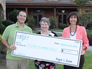 Roger S. Green presents check to Friends Board Member, Pam Tokarz,  and county staff support for Friends, Jennifer Orton.