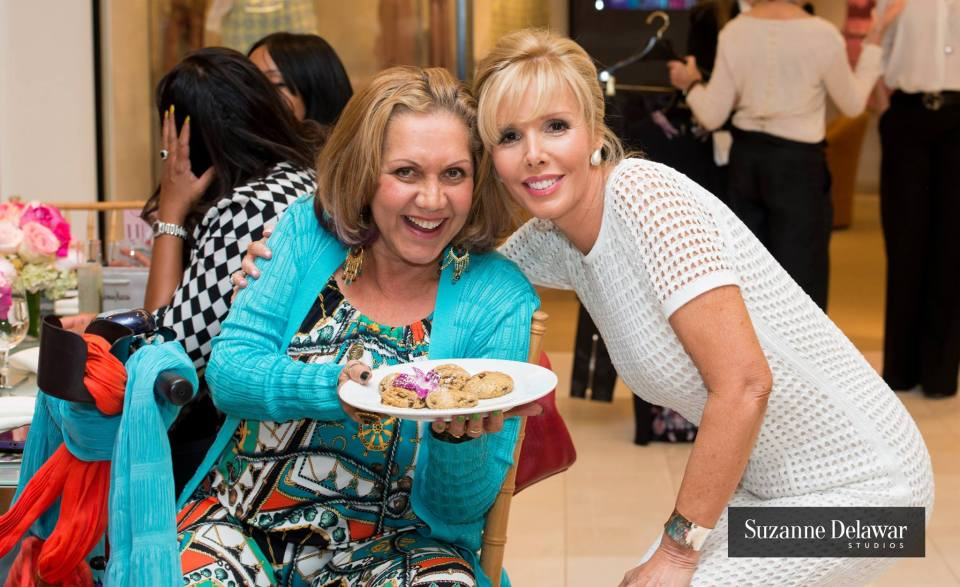 The lovely Norma Jean Abraham (left) tempts Kathleen Monahan with the famous Neiman Marcus cookies!