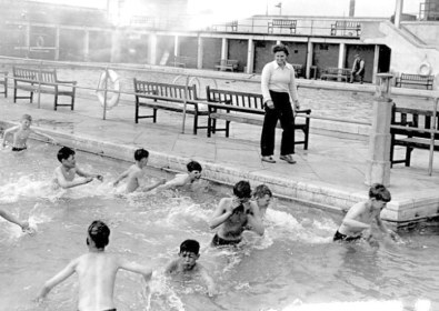Peggy White teaching school lads in the teaching/paddling pool