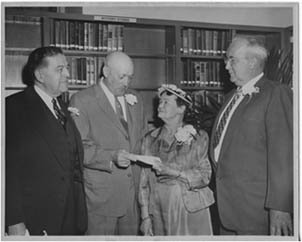 This is a picture of Andrew J. Snyder handing over the deed to All Saints Chapel to Anna Mae Auchmoedy, President of the Rosendale Library Association, on April 13, 1959.  They are flanked (l to r) by Frederick Snyder and Edward Huben.