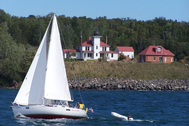 Sailing past the Raspberry Island lighthouse