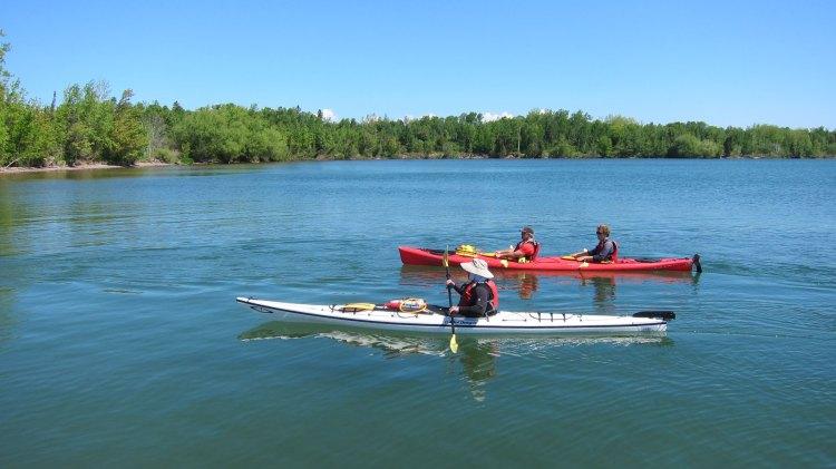 Kayakers approaching Sand Island