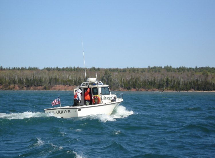 park boat operating on Lake Superior at Little Sand Bay