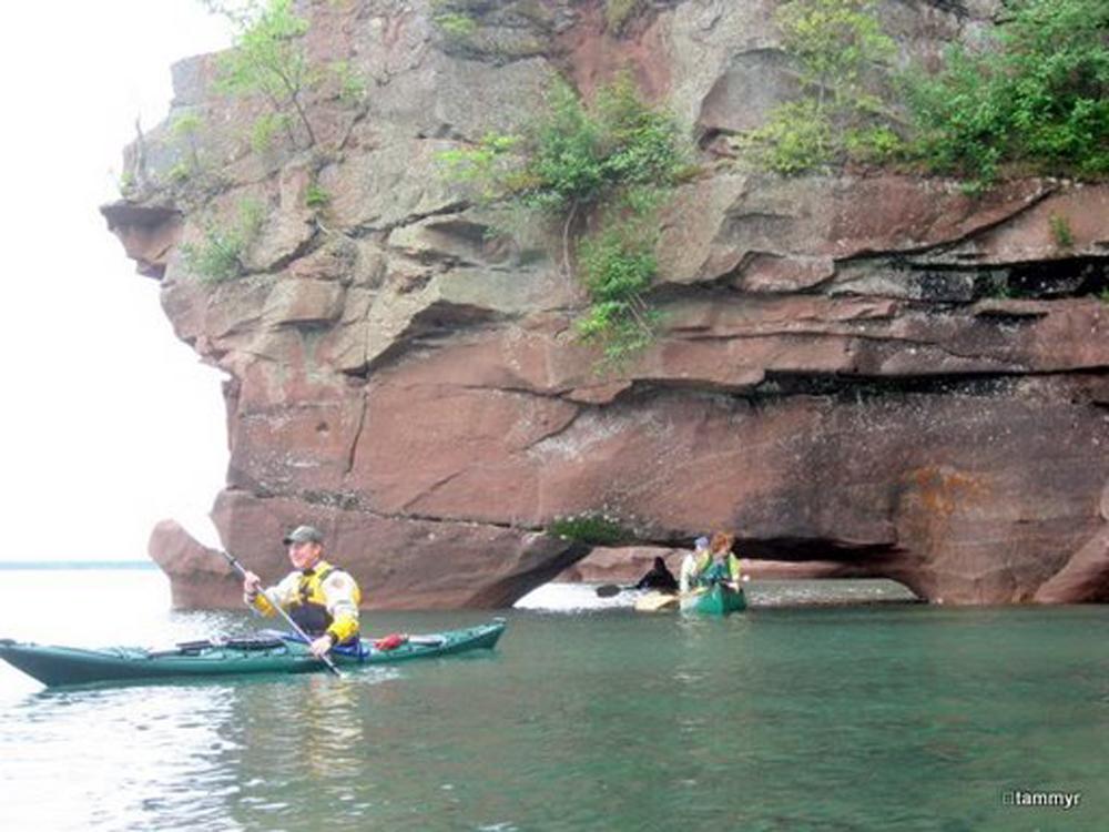 Dan leading a group of sea kayakers at the sea caves