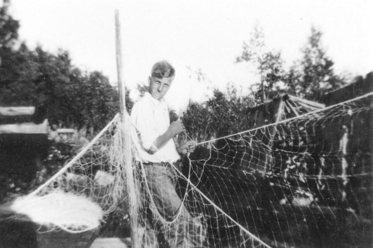 Julian Nelson works on a gill net