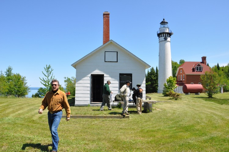 Stu Whipple (left) at the Outer Island lighthouse