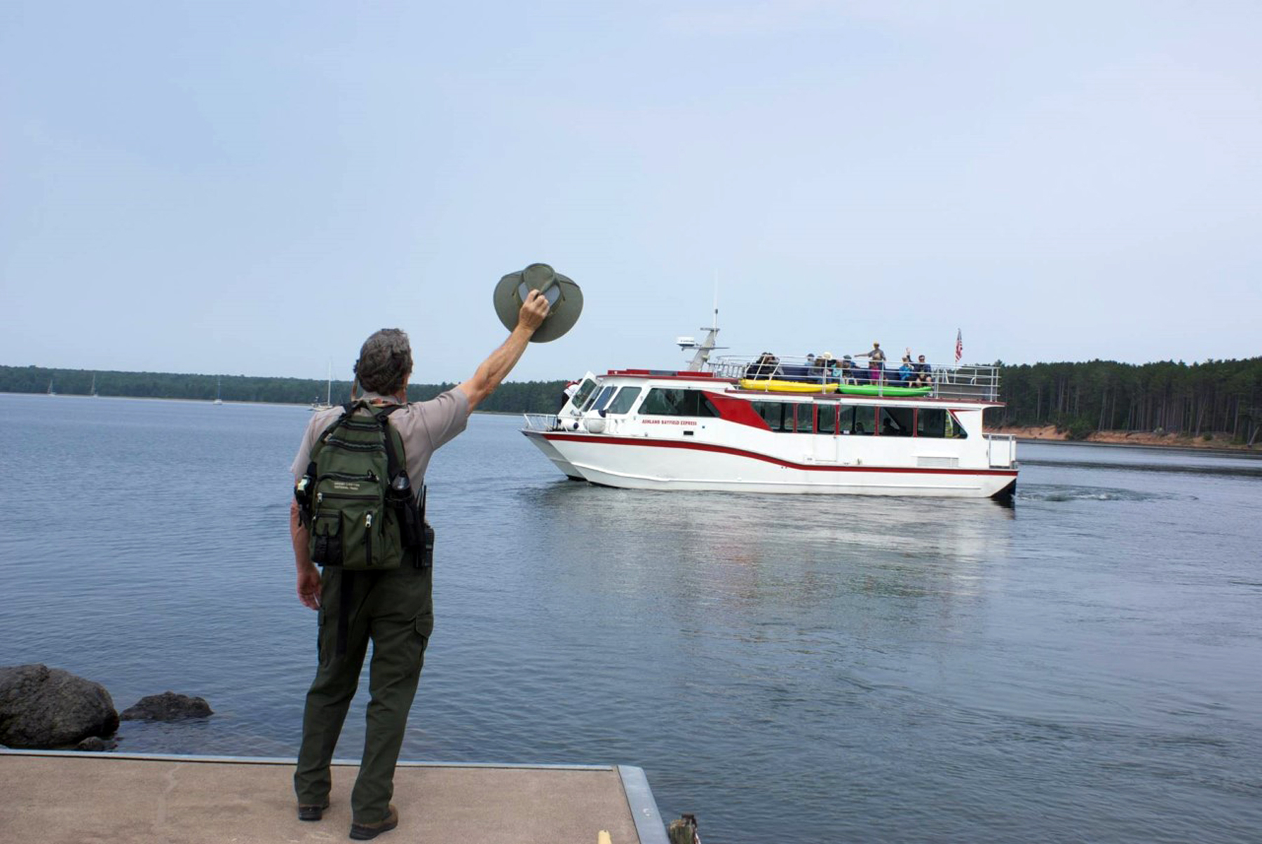 Stu waves goodbye to the cruise boat departing from Stockton Island