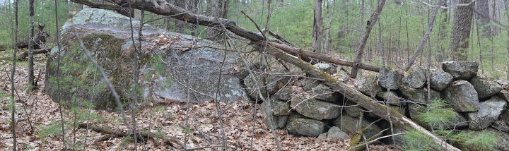 Large Boulder Incorporated into Wall