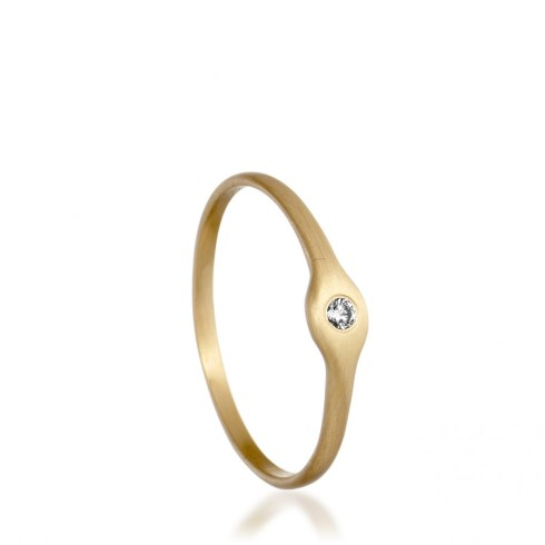 Astley Clarke's Canina ring is a beautiful example of minamism and at £325 an incredible bargain. Just 3mm at it's widest, this recycled 18ct gold designed by Marian Maurer would work equally as well as engagement ring or wedding band.