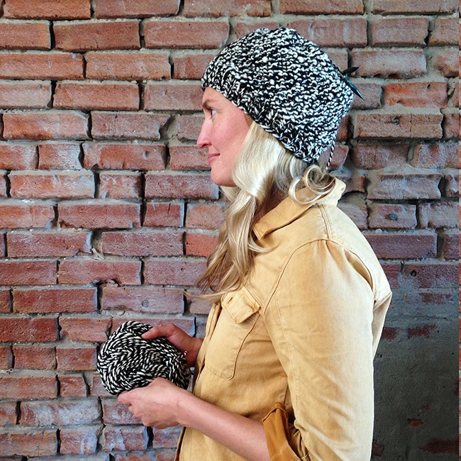 Rebekka Seale in hat knitted from her handspun