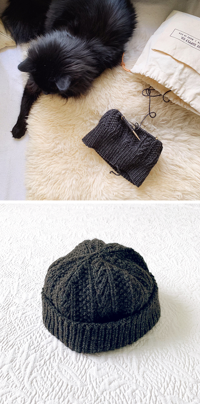 Cabled Dad Hat knitting in progress with cat