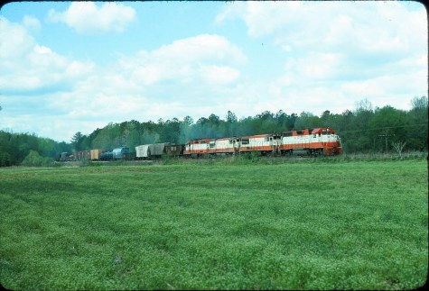 GP38AC 653, U25B 820, U30B 838 and GP35 702 (location unknown) in April 1977
