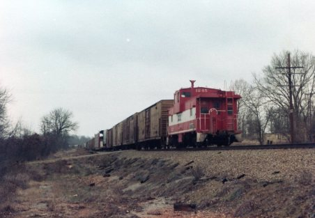 U30B 832, SD45s 920 and 917, and Caboose 1245 North of Thayer, Missouri on December 31, 1979 (R.R. Taylor)