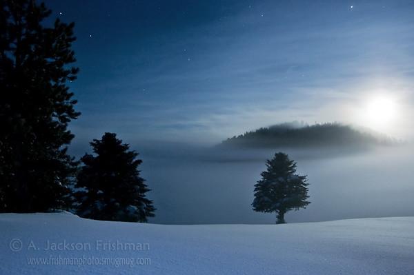 Moonrise through mist in Valles Caldera National Preserve, Jemez Mountains, New Mexico