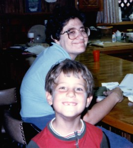 Let me leave you with one more picture of your host on this blog from a long time ago. That's my mother behind me. Again, I'm 7 or 8 here because we are in the new house, and I'm still tiny.